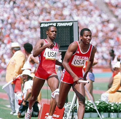 4_x_400_Relay_at_the_Summer_Olympics_by_Ken_Hackman,_August_1984_(DOD_DD-SC-85-09738)_(514592022), public domain